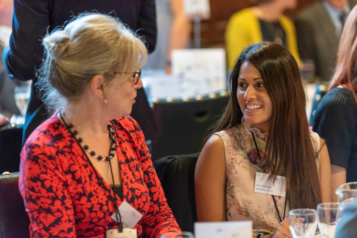 Two women chatting about Employee Ownership at a conference