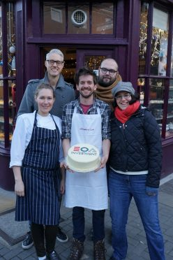 Konditor & Cook staff with investment award cake